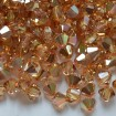 Biconic Swarovski 6 mm - Crystal Metallic Sunshine